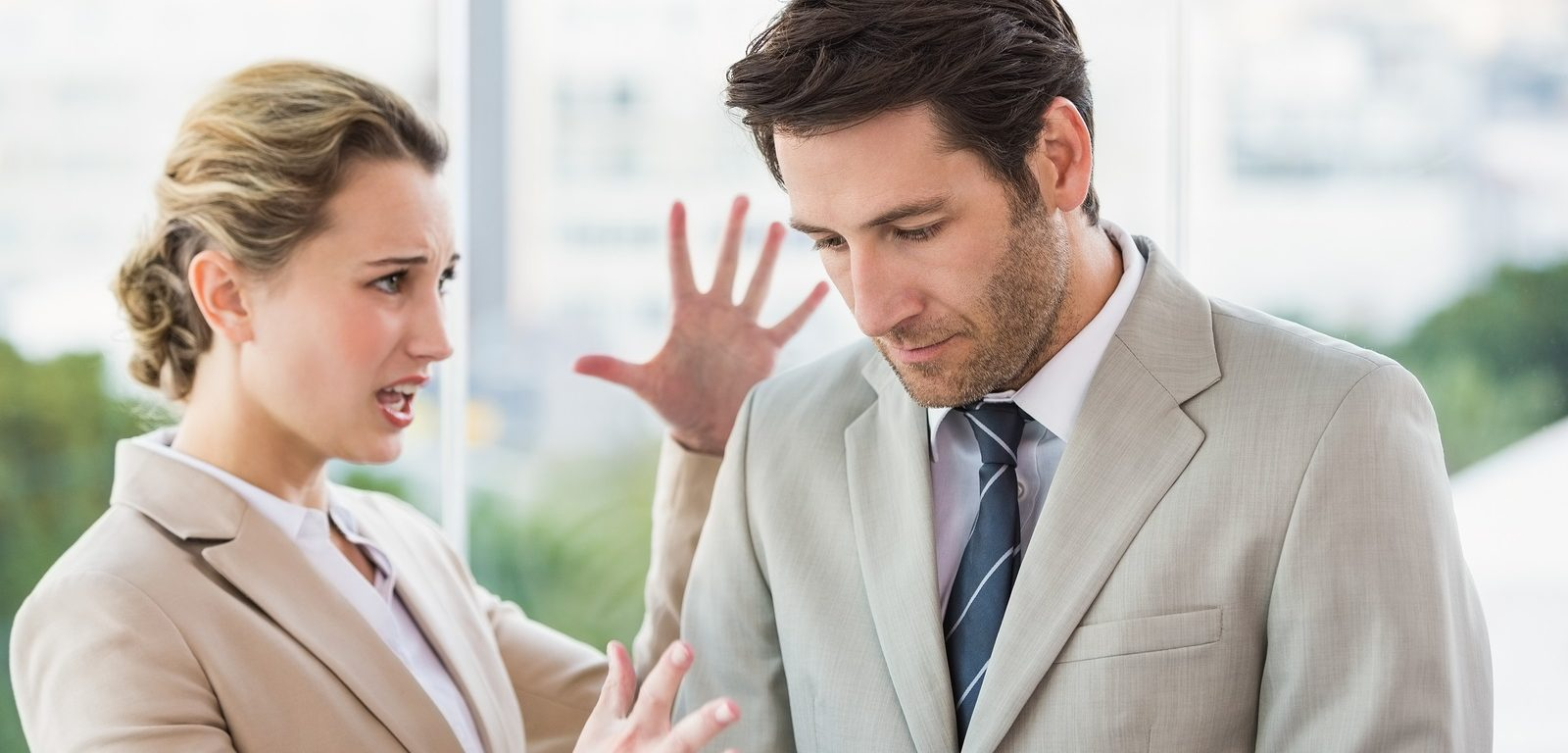 Woman shouting at male colleague in office