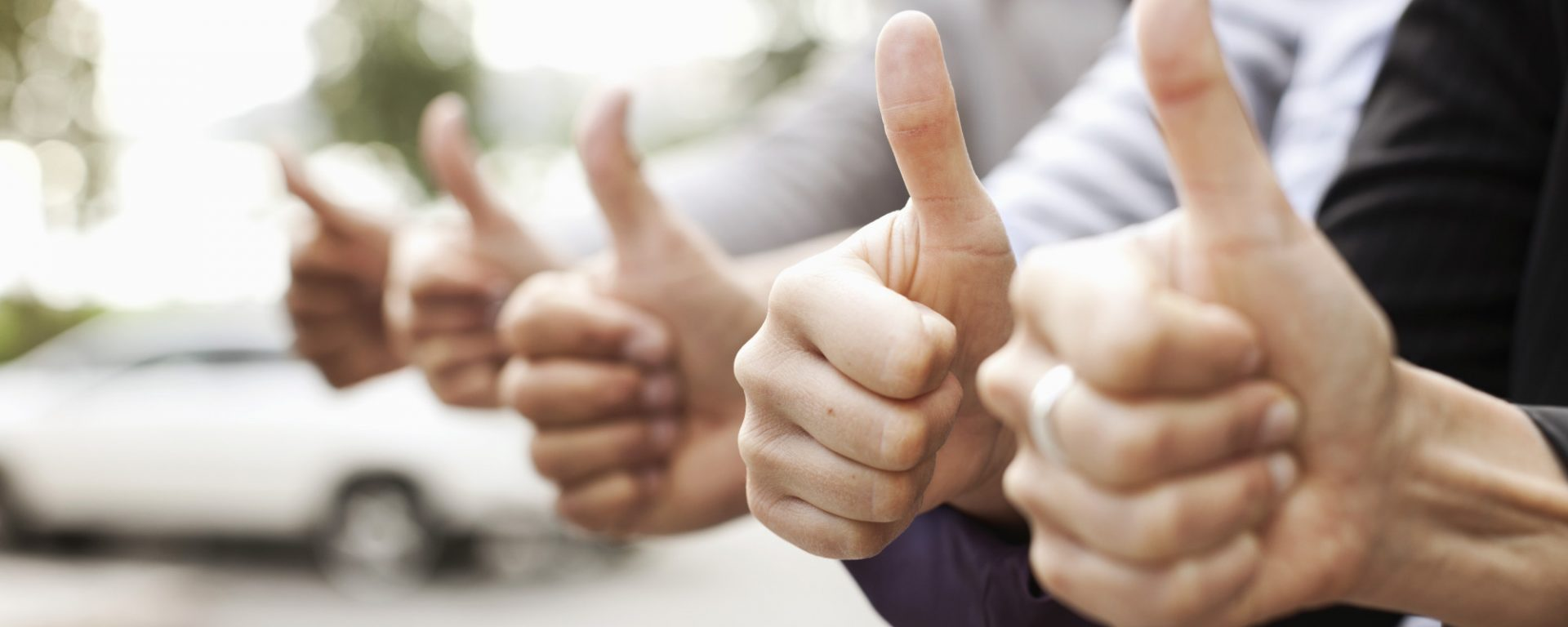 Human hands showing thumbs up sign